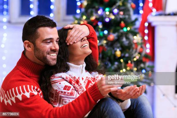 Couple having fun at home for Christmas