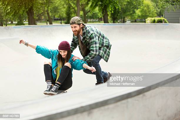 Couple having fun at skate park