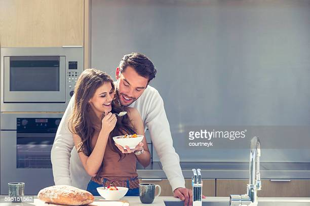 couple having fun eating breakfast. - wife stock pictures, royalty-free photos & images