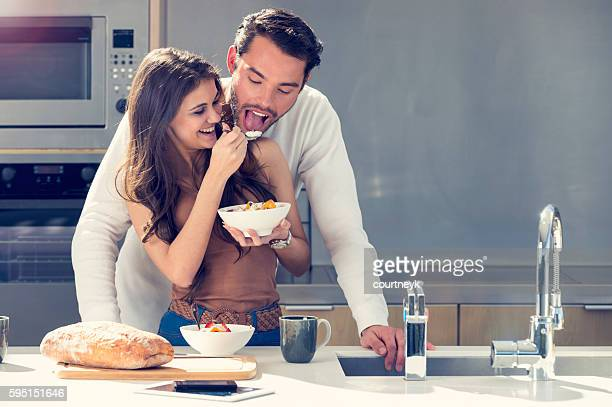 Couple having fun eating breakfast.