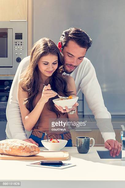 Couple having fun eating breakfast.