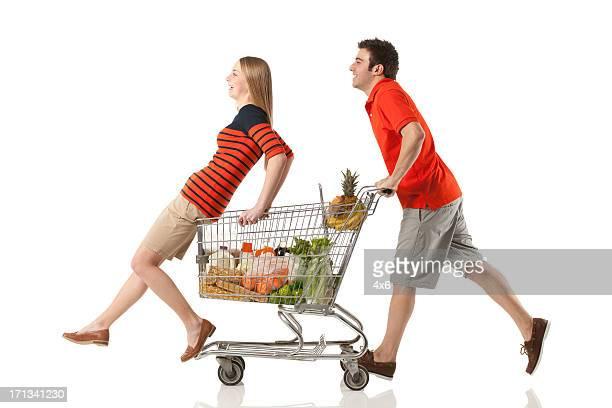 Couple having fun in a supermarket