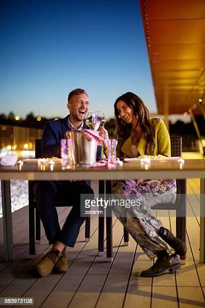 Couple having fun in outdoor restaurant