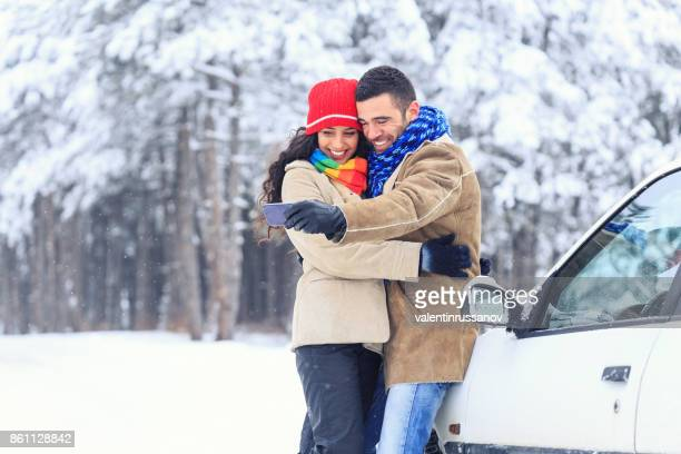 Couple having fun in snow forest