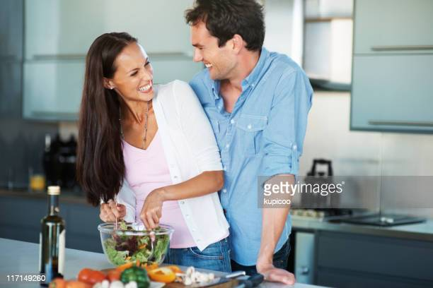couple having fun in the kitchen - mid adult couple stock pictures, royalty-free photos & images