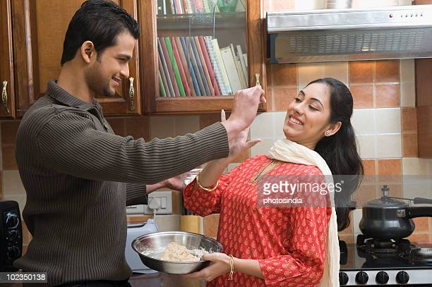 Couple having fun in the kitchen while cooking