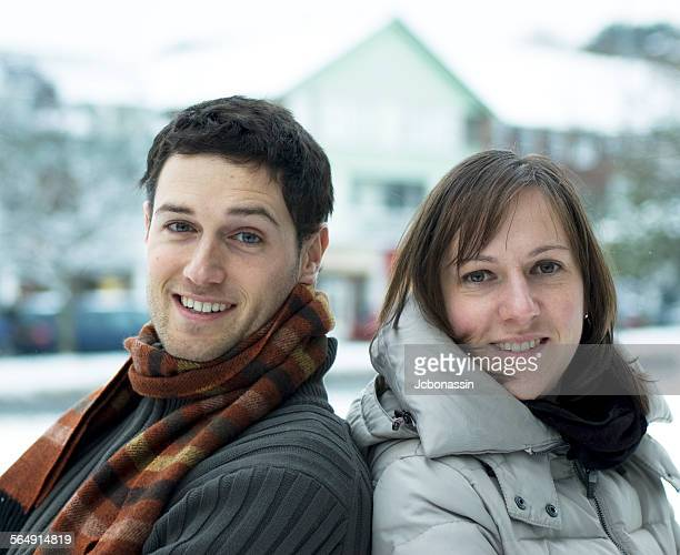 couple having fun in the snow - jcbonassin stock pictures, royalty-free photos & images
