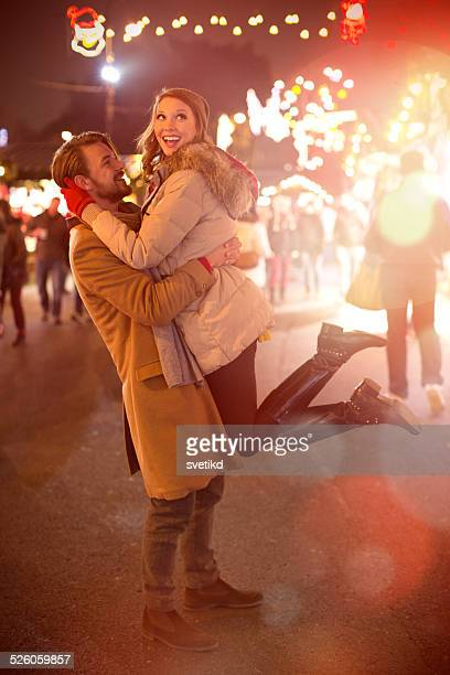 Couple having fun outdoors at winter fair.