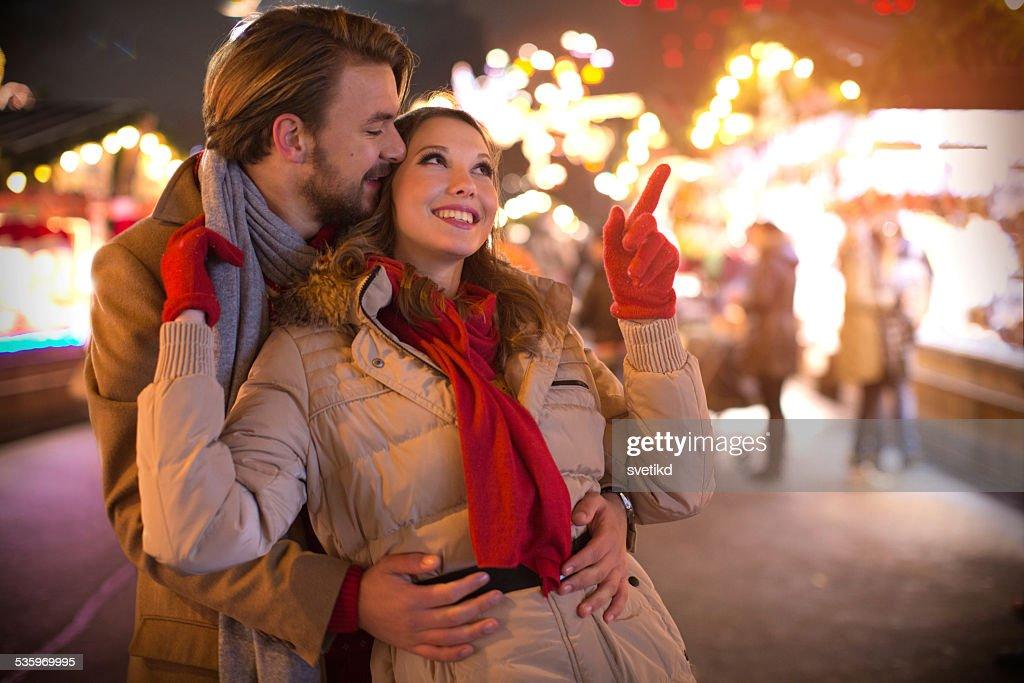 Couple having fun outdoors at winter fair. : Stock Photo