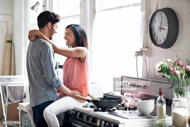 couple having fun while cooking - flirting stock pictures, royalty-free photos & images