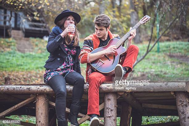 Couple having fun with guitar