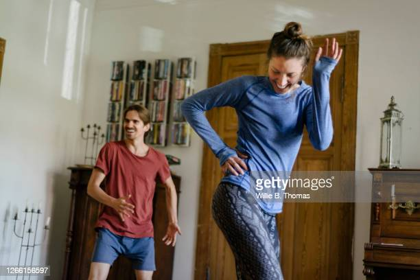 couple having fun working out at home together - dancing stock pictures, royalty-free photos & images
