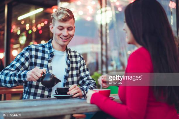 Couple having good time while sitting in a cafe.