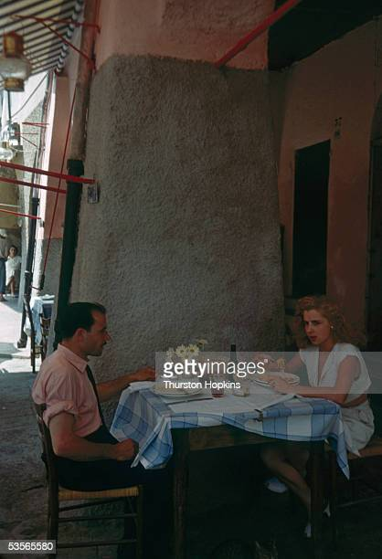 A couple having lunch al fresco in Portofino Italy 1st December 1951 Original publication Picture Post 5599 Portofino unpub