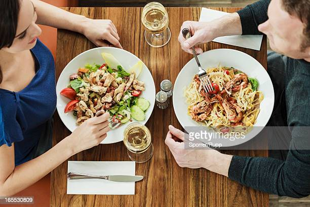 Couple having lunch at cafe