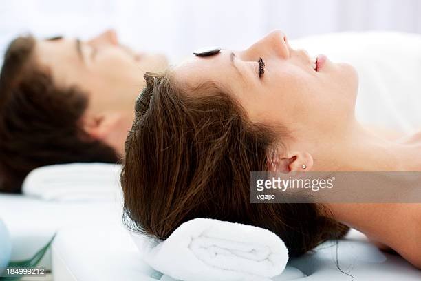 Couple Having Massage At Spa Center