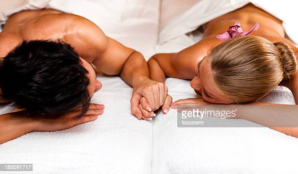 couple having massage - sensual massage stock photos and pictures