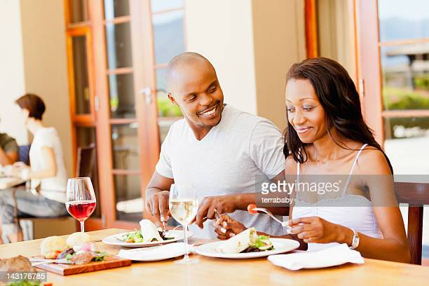 Couple Having Meal in Outdoor Restaurant on Summer Day