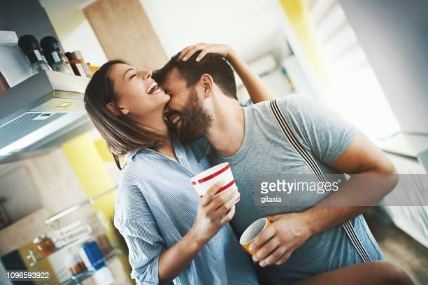 couple having morning coffee at home. - gilaxia foto e immagini stock