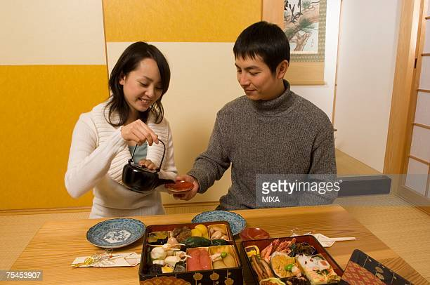 Couple having New Year's Day meal