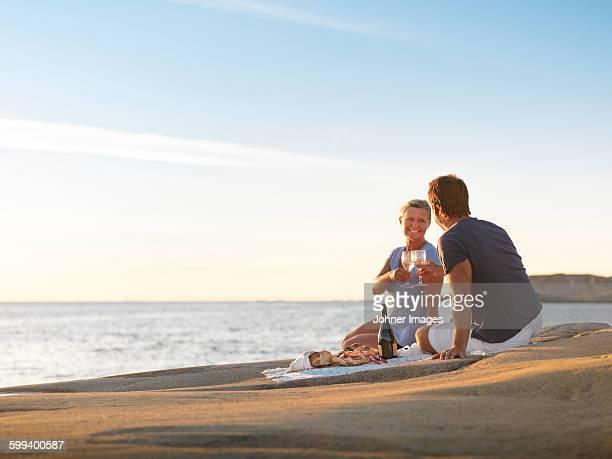 Couple having picnic at sea