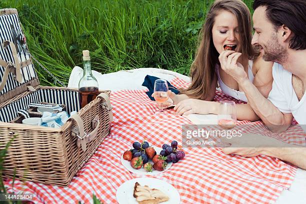 Couple having picnic in meadow