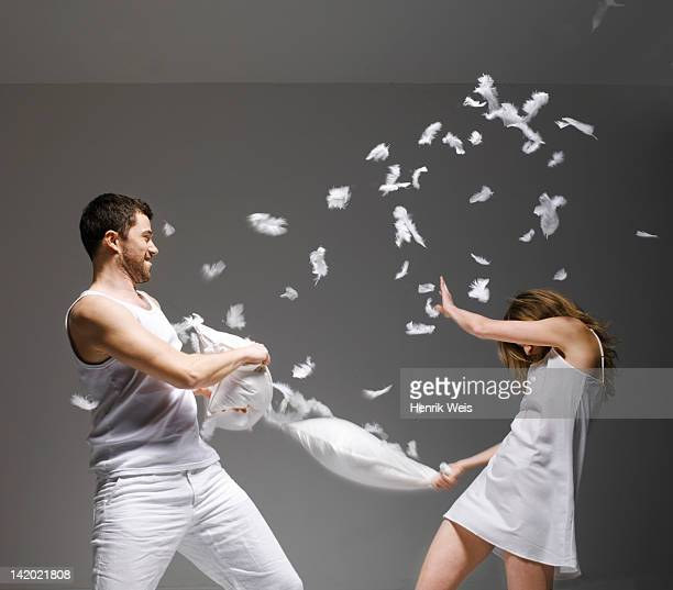 Couple having pillow fight