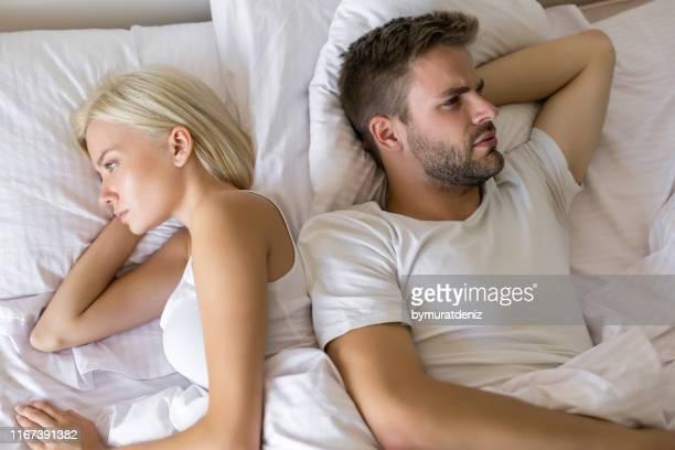 couple having problems in bed - coppia a letto foto e immagini stock