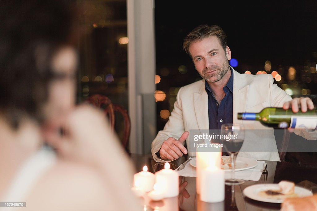 Couple having romantic dinner at home : Stock Photo