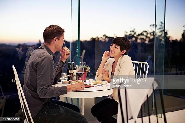 Couple having romantic dinner at restaurant