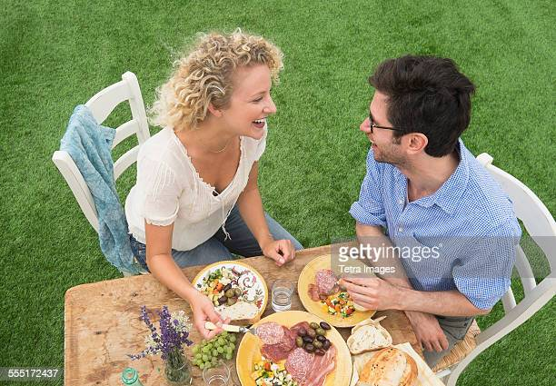 Couple having rustic breakfast
