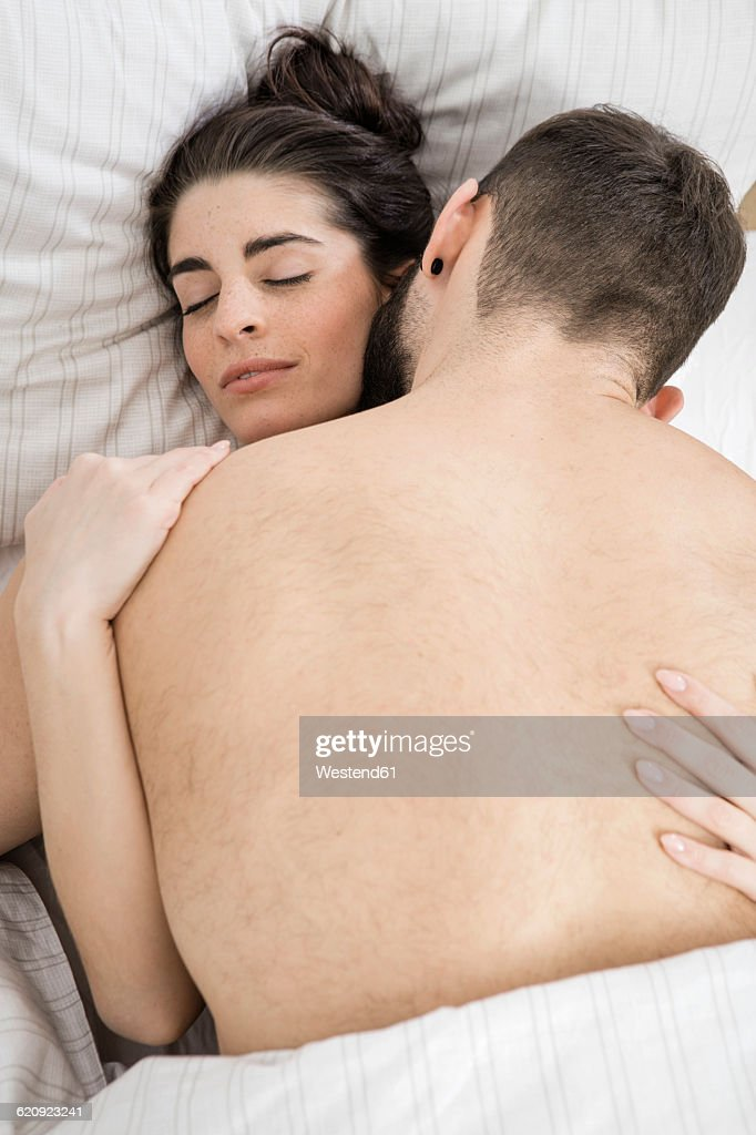Couples having sex in bed