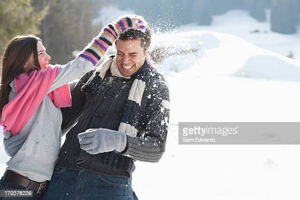 couple having snowball fight - teasing stock pictures, royalty-free photos & images