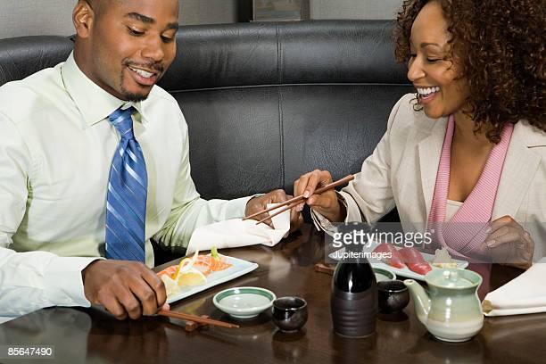 Couple having sushi dinner