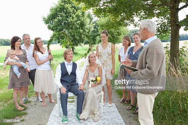 Couple having wedding outdoors
