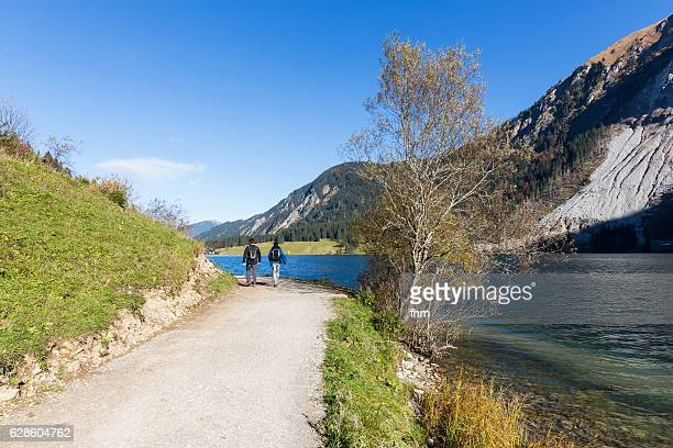 Couple/ hikers near the Vilsalpsee in the alp mountains (Reutte/ Tirol/ Austria)