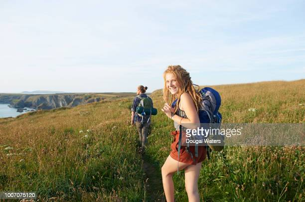 couple hiking along atlantic coastline. - atlantic ocean stock pictures, royalty-free photos & images