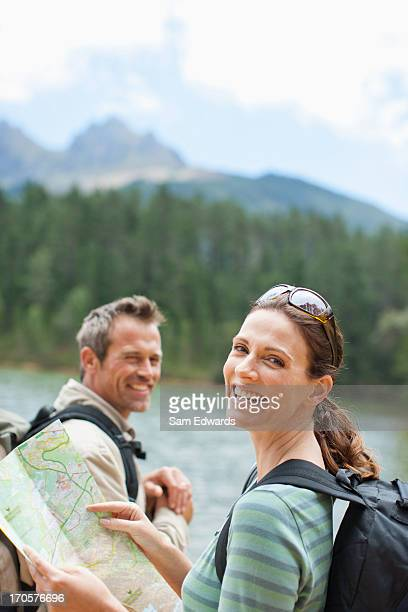 Couple hiking and looking at map in remote area