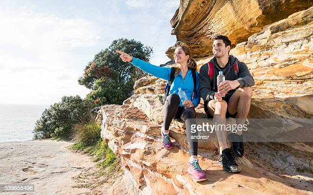 Couple hiking and pointing away