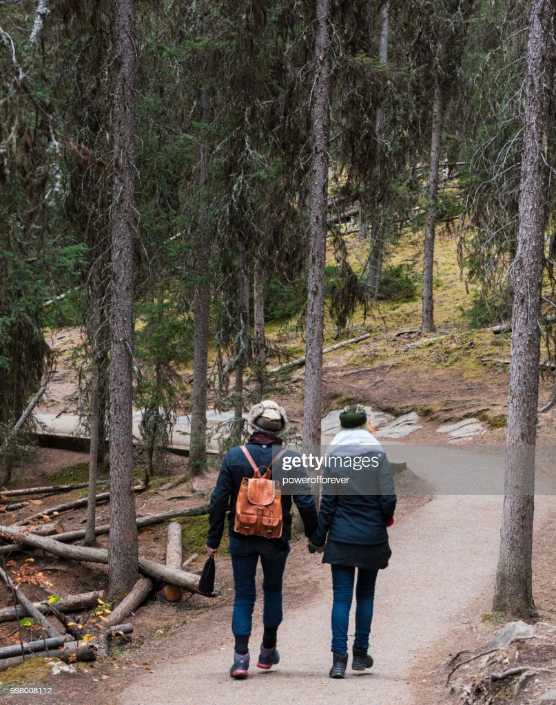 Couple Hiking at Johnston Canyon in the Canadian Rocky Mountains, Alberta, Canada : Stock Photo