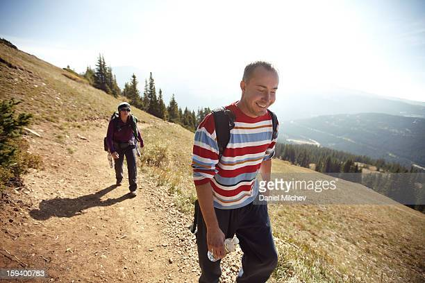 Couple hiking high in the rockies.