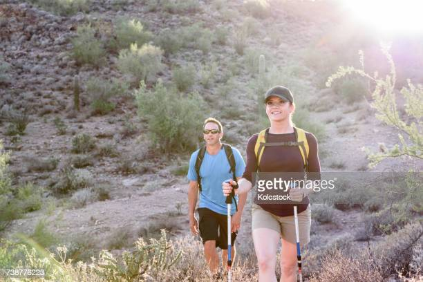 couple hiking in desert - phoenix arizona stock photos and pictures