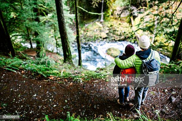 couple hiking in forest gorge - columbia river gorge stock pictures, royalty-free photos & images