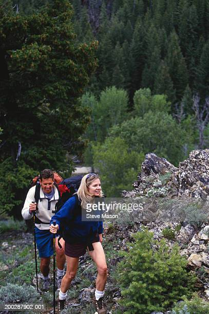 Couple hiking in mountains, elevated view