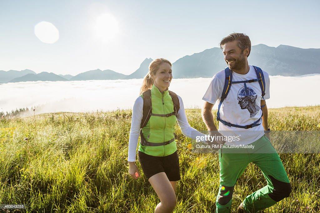 Couple hiking in mountains, Tyrol, Austria : Stock Photo