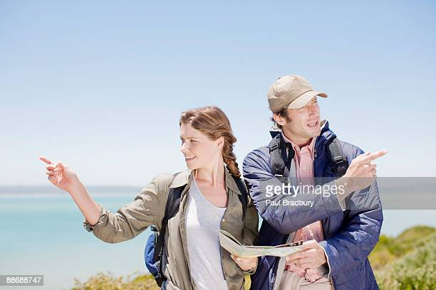 Couple hiking in remote area and looking at map