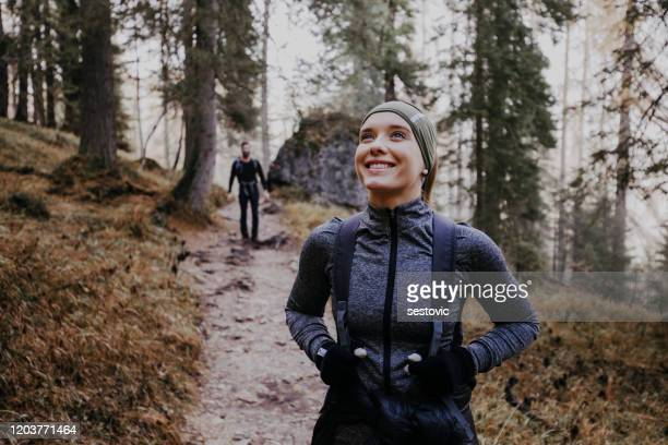 couple hiking in the dolomites - hiking stock pictures, royalty-free photos & images