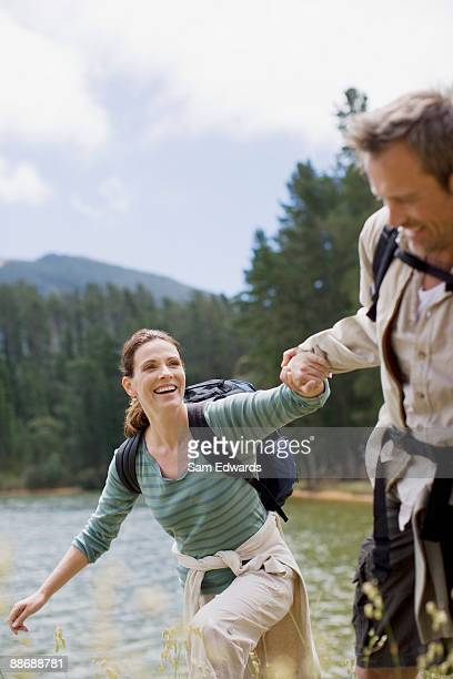 Couple hiking near lake in remote area