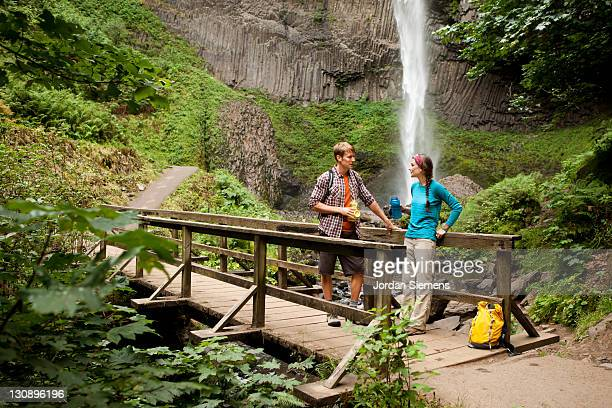 A couple hiking near waterfalls.