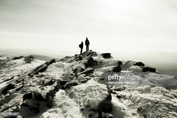Couple hiking on mountain in winter